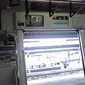 Photos: 電車の中の液晶広告